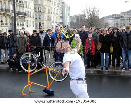 PARIS, FRANCE - APRIL 20, 2014: A street performer performing for tourists on a Paris street