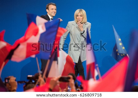 PARIS, FRANCE - APRIL 23, 2017 : Emmanuel Macron with his wife Brigitte, to celebrate his first place in the first round of the french presidential election with his political party en marche.