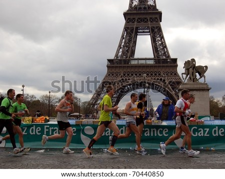 PARIS, FRANCE - APRIL 6: Group of runner take refreshment near Eiffel tower  the Paris Marathon, April 6, 2008 in Paris, France