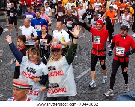 PARIS, FRANCE - APRIL 6: Group of runners start on Champs Elysees  the Paris Marathon, April 6, 2008 in Paris, France