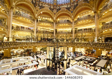 PARIS, FRANCE - APRIL 24 : inside part of the famous Galeries Lafayette with it's brand stands stalls such as Chanel and Lancome on April 24th 2013 in Paris, France