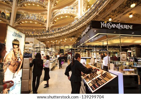 PARIS, FRANCE - APRIL 24 : inside part of the famous Galeries Lafayette with it's brand stands Yves Saint Laurent, Jean Paul Gaultier, Lancome and customers on April 24th 2013 in Paris, France