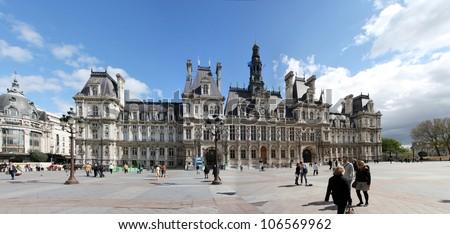 PARIS, FRANCE - APRIL 11: Unidentified people in front of Hotel de Ville, Paris, France at April 11, 2012. This building housing the Mayor of Paris since 1977.