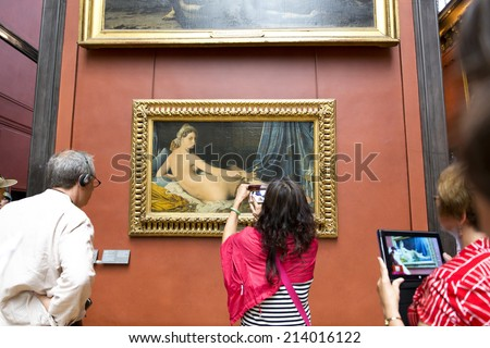 PARIS, FRANCE, August 6, 2014: Grande Odalisque, also known as Une Odalisque or La Grande Odalisque, is an oil painting of 1814 by Jean Auguste Dominique Ingres. The work is displayed in the Louvre.