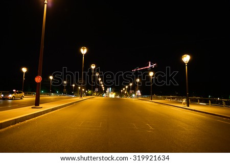 PARIS, FRANCE - AUGUST 11, 2015: Paris streets at night. Paris, aka City of Love, is a popular travel destination and a major city in Europe