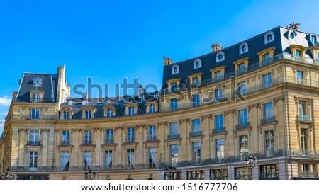 Paris, France, beautiful buildings place des Victoires, typical parisian facades and windows