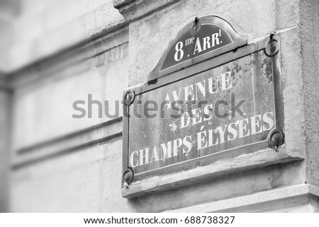 Paris, France - Champs Elysees street sign. One of the most famous streets in the world. Black and white vintage style.