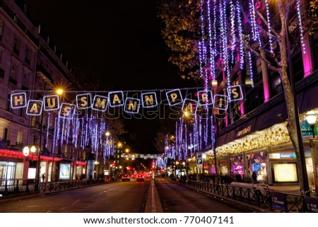 paris france december 4 2017 christmas lights on haussmann boulevard and parisian