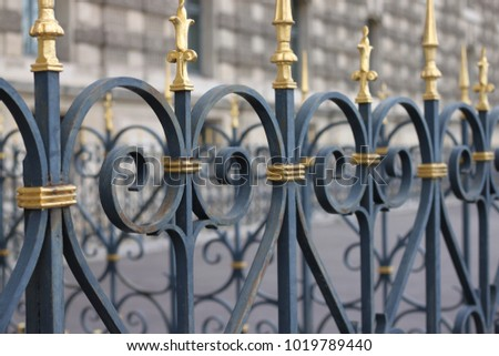 Paris, France, February, 2016: A close-up of heart or ace-shaped, gold-tipped gates in Paris. #1019789440