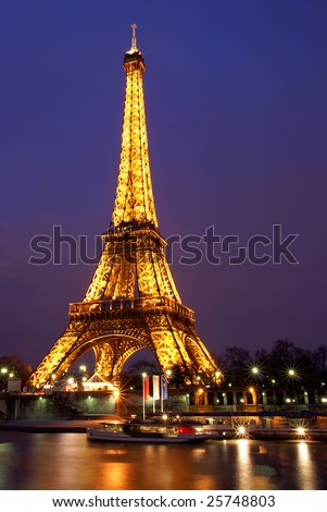 PARIS, FRANCE, 2 FEBRUARY, 2009: Eiffel tower of Paris lit at twilight. The Eiffel tower is the most visited monument of France.