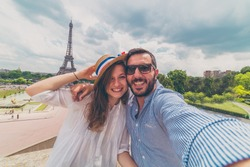 Paris, France, happy tourist couple in holiday take selfie photo taveling in Europe trip