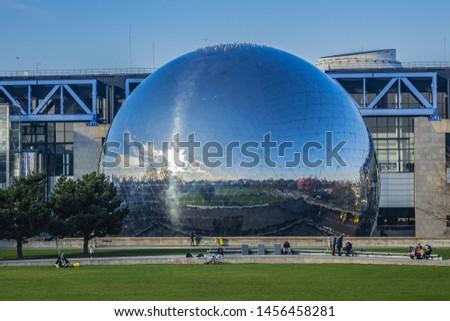 """PARIS, FRANCE - JANUARY 13, 2018: Mirror-ball building """"Geode"""" in Parc de la Villette - IMAX Theater. #1456458281"""