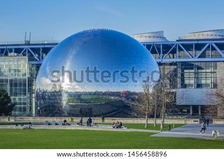 """PARIS, FRANCE - JANUARY 13, 2018: Mirror-ball building """"Geode"""" in Parc de la Villette - IMAX Theater. #1456458896"""