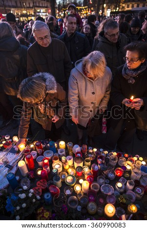 PARIS, FRANCE- January 10, 2016: Place de la Repbublique, ceremony to commemorate victims of the bombing and shooting rampage, Charlie Hebdo terrorist attack and