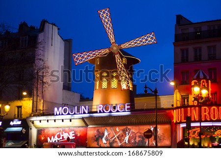 PARIS, FRANCE - JANUARY 13 : The Moulin Rouge is a famous cabaret built in 1889, locating in the Paris red-light district of Pigalle on January 13th, 2013