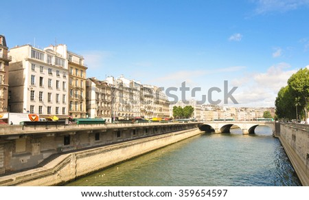Paris, France - July 7, 2015: Architectural panorama of bridge over the river Seine in Paris, France. #359654597