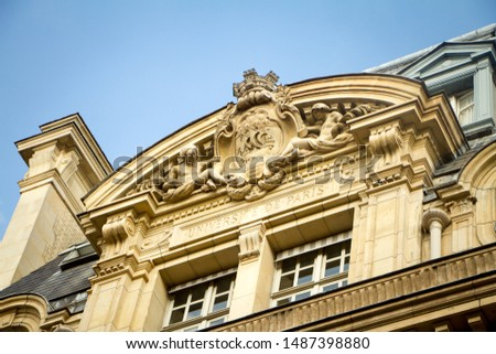 Paris, France - July 7, 2018: Bottom view of the architectural composition at the main entrance to the Sorbonne University in Paris with a bas-relief of the coat of arms of Paris #1487398880