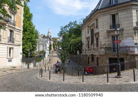 PARIS, FRANCE – JULY 18, 2017: Road in Montemart, Paris #1180509940