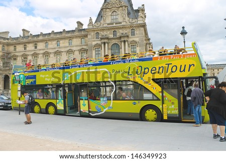 PARIS, FRANCE - JULY 10:Tourists bus in the heart of Paris on July 10, 2012. Paris is one of the most visited cities in the world
