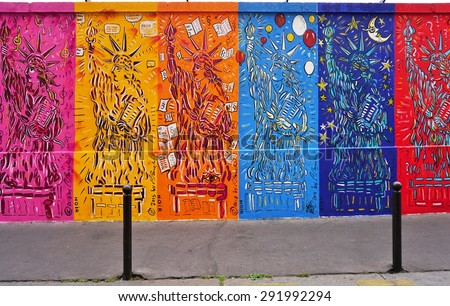 PARIS, FRANCE -20 JUNE 2015- The mural exhibit Art Liberte du Mur de Berlin au Street Art lines the rue de Alsace street in the 10th arrondissement of Paris near the Gare de Est railway station.
