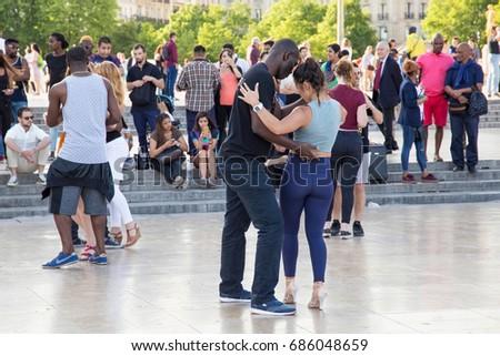 PARIS, FRANCE - JUNE 24, 2017: Unknown young people dancing on the Place de Trocadero near Palais de Chaillot in Paris. #686048659