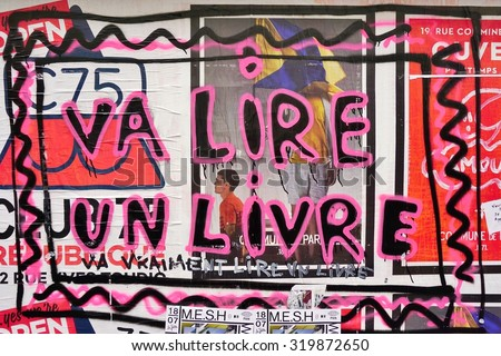 PARIS, FRANCE -16 JUNE 2015- Va Lire Un Livre graffiti street art in the French capital. Paris has become one of the European centers for street art.