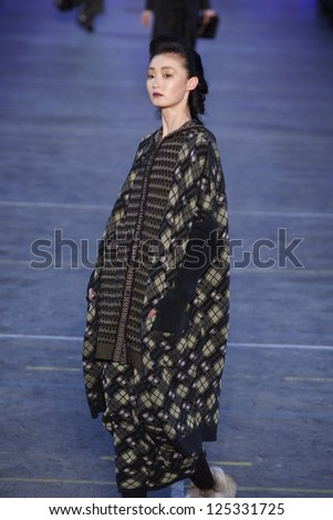 PARIS, FRANCE - MARCH 06: A model walks the runway at the Kenzo fashion show during Paris Fashion Week on March 6, 2011 in Paris, France.