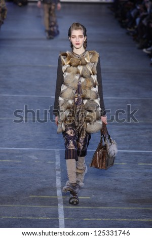 PARIS, FRANCE - MARCH 06: A model walks the runway at the Kenzo fashion show during Paris Fashion Week on March 6, 2011 in Paris, France. - stock photo