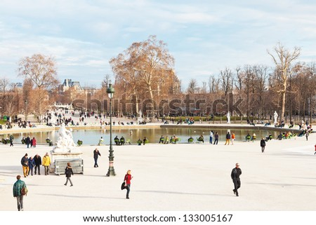 PARIS, FRANCE - MARCH 5: Grand Basin Octagonal in Tuileries Garden. In 1664 landscape architect Andre Le Notre redesigned garden and placed basins with fountains, in Paris, France on March 5, 2013