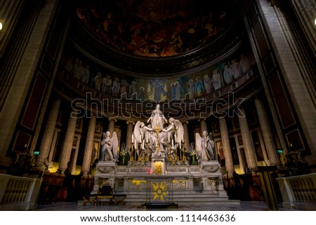 PARIS, FRANCE - MARCH 16, 2015: Interiors and architectural details of Eglise de la Madeleine. Madeleine Church was designed in its present form as a temple to the glory of Napoleon's army. #1114463636