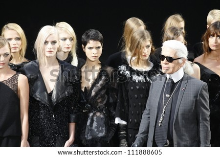 PARIS FRANCE MARCH 08 Karl Lagerfield and models walks the runway during the Chanel Autumn Winter 2011 2012 show during Paris Fashion Week at Grand Palais on March 8 2011 in Paris France