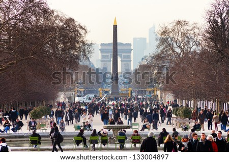 PARIS, FRANCE - MARCH 5: Luxor Obelisk and triumphal arch from Tuileries Garden. Jardin des Tuileries was first opened to the public in 1667, in Paris, France on March 5, 2013