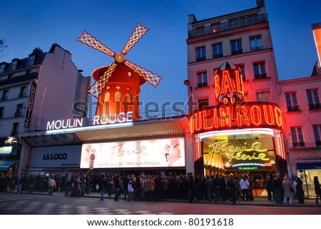 PARIS, FRANCE - MARCH 19: Moulin Rouge is a famous cabaret built in 1889, located in the Paris red-light district of Pigalle. Many movies and books are made about the Moulin Rouge, March 19, 2007 in paris, france