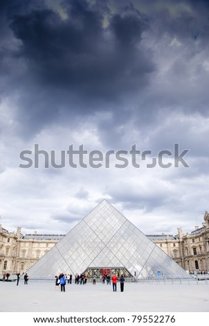 PARIS,FRANCE - MAY 26: Entry to Louvre Museum on May 26, 2011 in Paris. The large pyramid was completed in 1989, it has become a landmark of the city of Paris.