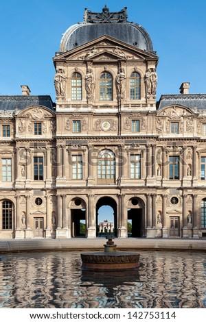 PARIS, FRANCE - MAY 29: Paris, Louvre, Clock or Sully Pavilion (Pavilion de l'Horloge du Louvre) in  Paris, France.  With 8.8 million annual visitors, Louvre is the most visited museum worldwide.