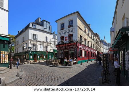 PARIS, FRANCE - MAY 19: The charming streets of Montmartre hill are full of art galleries, cafes and shops to walk about. It's one of the most visited landmarks in Paris. May 19, 2011 in Paris, France