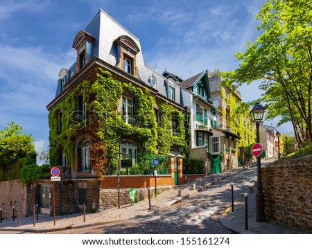 PARIS, FRANCE - MAY 19: The charming streets of Montmartre hill are full of art galleries, cafes and shops to walk about. It's one of the most visited landmarks in Paris. May 19, 2010 in Paris, France