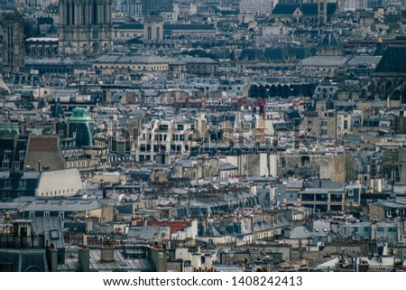 Paris France May 25, 2019 View of the buildings and roofs of Paris from the Sacre Coeur monument in Paris in the afternoon