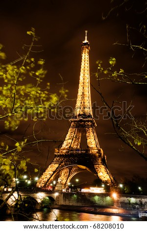 PARIS, FRANCE - NOVEMBER 12: The Eiffel tower lit at Night on November 12, 2010 in Paris, France. The most visited monument of France.