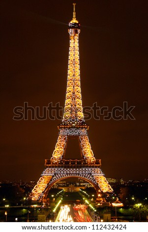 PARIS, FRANCE - OCTOBER 26: Ceremonial lighting of the Eiffel tower on October 26, 2006 in Paris, France. The Eiffel tower is the most visited monument of France. - stock photo