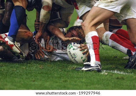 PARIS, FRANCE-OCTOBER 14, 2007: english and french rugby players pushing in scrum, during the match France vs England, of the Rugby World Cup, in Paris.
