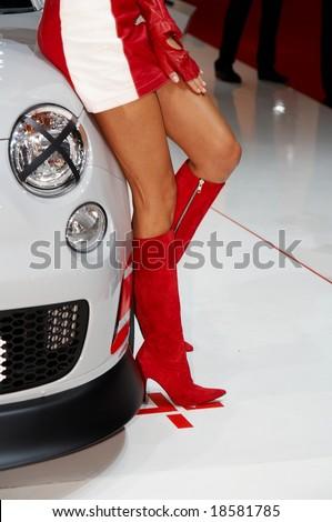 PARIS, FRANCE - OCTOBER 02:  legs female model posing near car close-up at Paris Motor Show 2008 on October 02, 2008