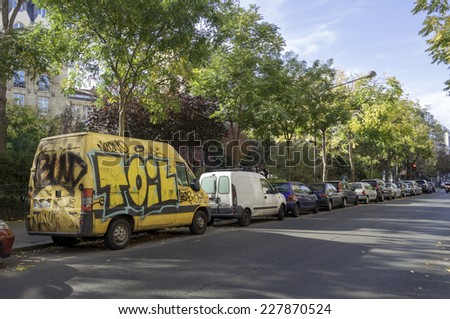 Paris, France - October 31: Street art graffiti on an a car in the city, October 31, 2014 in Paris, France