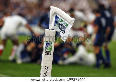 PARIS, FRANCE-OCTOBER 14, 2007: the try flag with in the background, english and french rugby players pushing in scrum, during the match France vs England, of the Rugby World Cup, in Paris.