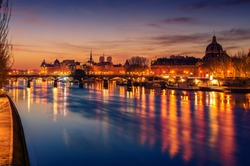 Paris, France: Seine river and the old town in beautiful sunrise of French winter