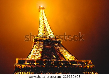 paris france september 14 2013 eiffel tower in the dark misty night and warm orange light. Black Bedroom Furniture Sets. Home Design Ideas