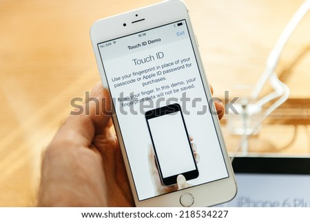 PARIS, FRANCE - SEPTEMBER 20, 2014: Hand holding a Apple iPhone 6 Plus displaying the new Touch Id App with  fingerprint option during the sales launch of the latest Apple Inc. smartphones