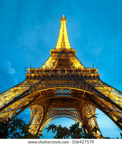 PARIS, FRANCE - SEPTEMBER 3: Illuminated Eiffel Tower at night. Blue night sky with clouds in background. The most popular tourist attraction in France. September 3, 2011, Paris, France, Europe. - stock photo
