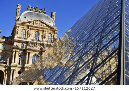PARIS, FRANCE - SEPTEMBER 23: Louvre Museum in Paris, France on September 23, 2013, major touristic attraction in Paris and the world's most visited museum, with more than 8 million visitors each year