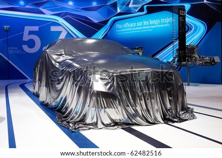 PARIS, FRANCE - SEPTEMBER 30: Paris Motor Show on September 30, 2010 in Paris, Mercedes-Benz CLS covered before presentation